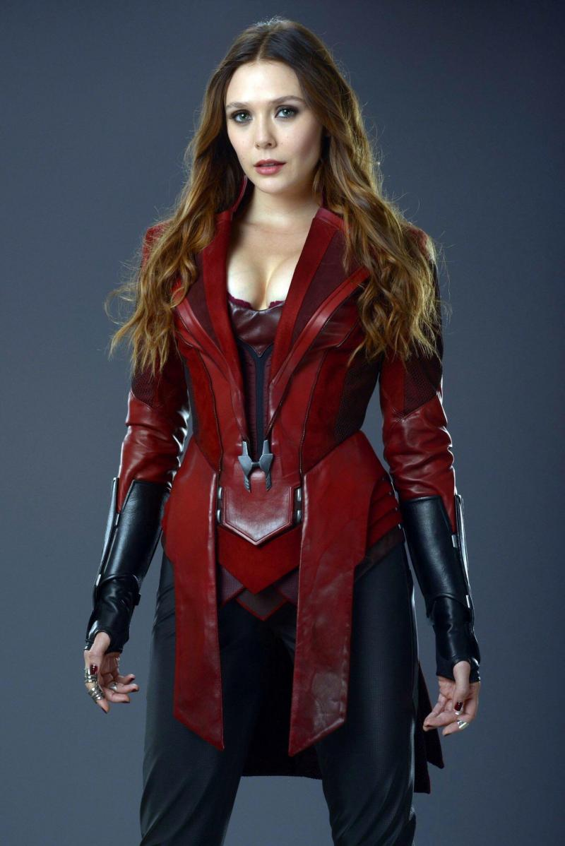 "Elizabeth Olsen speaks her Avengers cleavage corset costume is ""too revealing""."