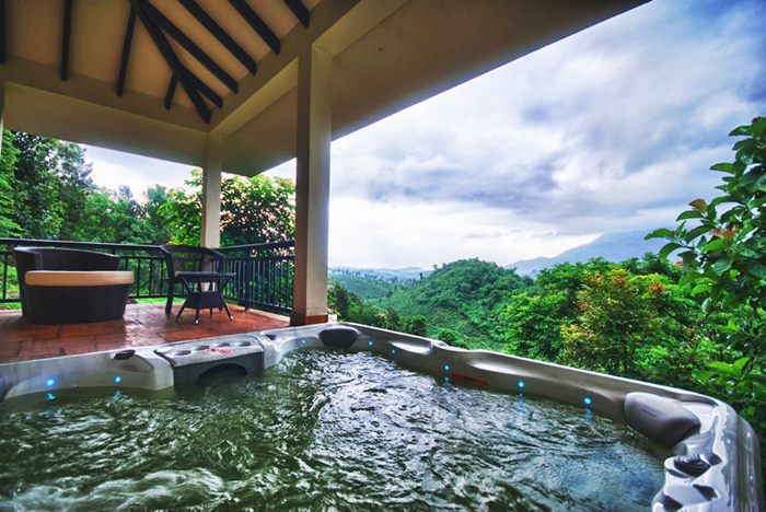Luxurious Resorts at Wayanad or Munnar in the middle of open-air Jacuzzi