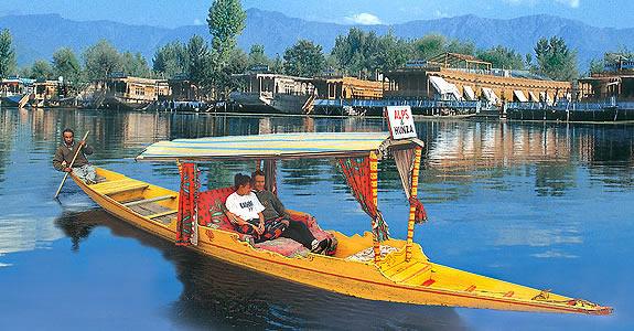 By enjoying the Shikara ride at Dal Lake of Srinagar